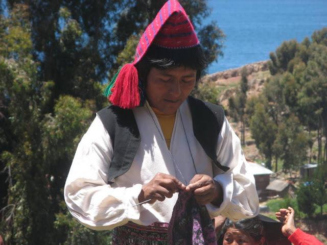 man knitting, Taquile Island, Peru