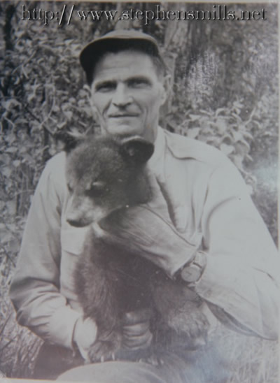 Photo of Alfred Jackson with bear cub