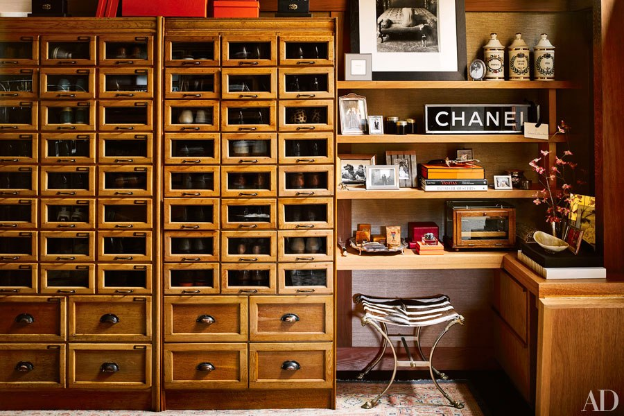 Wood cubbie cabinet in beautiful dramatic closet of Ken Fulk