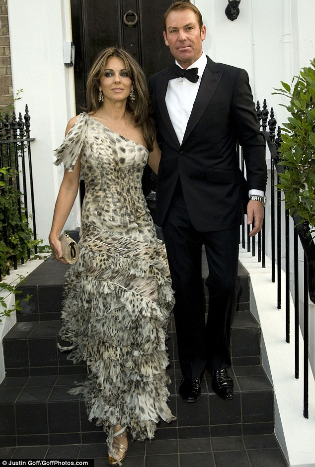 New face, new man: Shane Warne plays smooth-faced English gent as he accompanies Elizabeth Hurley to Elton John's White Tie and Tiara Ball