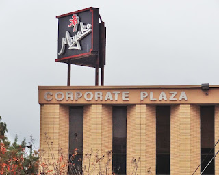 Miyako signage atop Corporate Plaza building on Kirby Drive