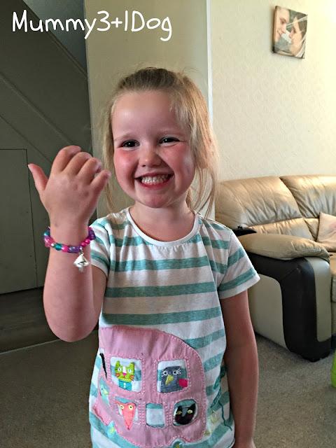 Summer with her bracelet