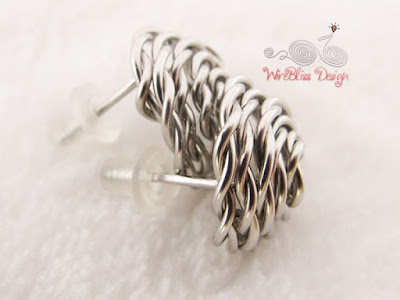 Close up of stainless steel wire wrapped rose studs earrings