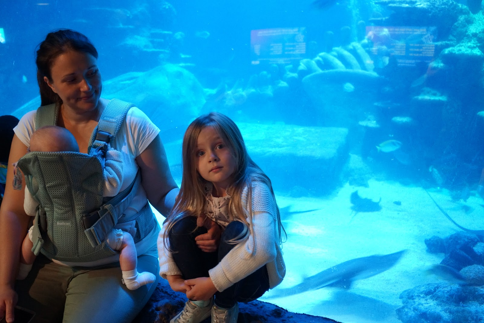 mum and daughter in front of fish tank
