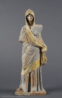 https://www.louvre.fr/en/oeuvre-notices/draped-woman-wearing-himation-and-holding-fan