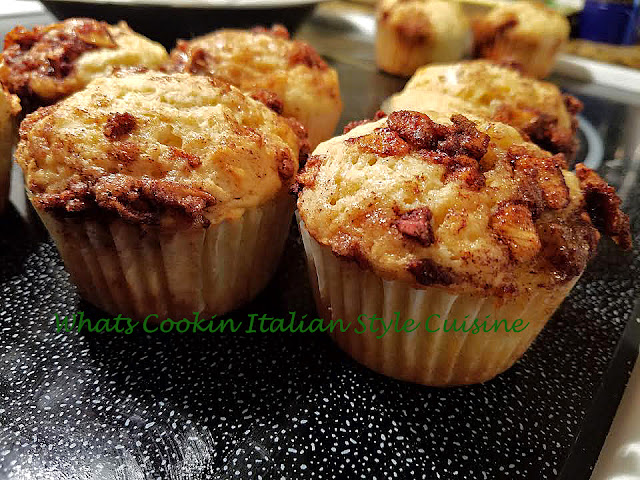Muffins with apple pie filling on top baked in the oven