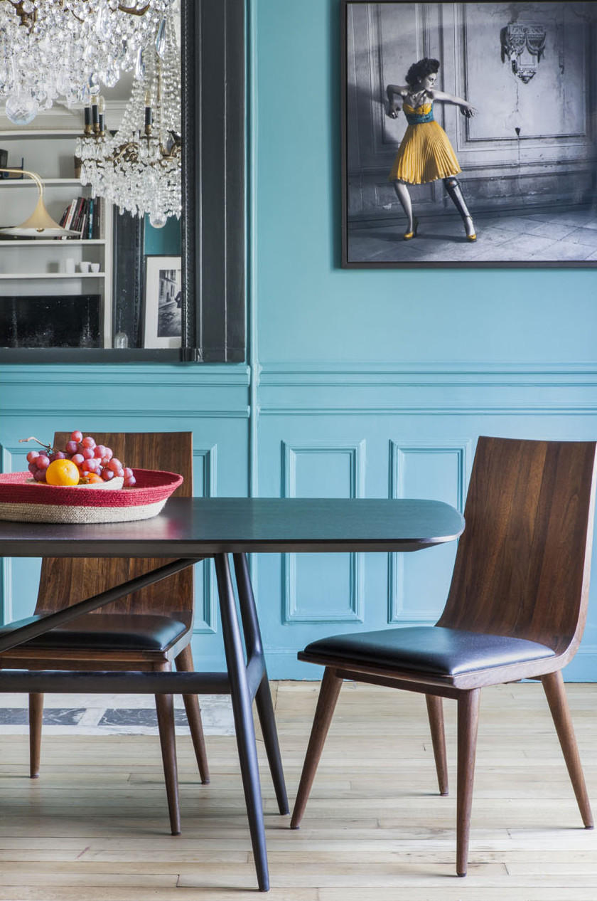 paris apartment with teal color, mid century modern furniture,