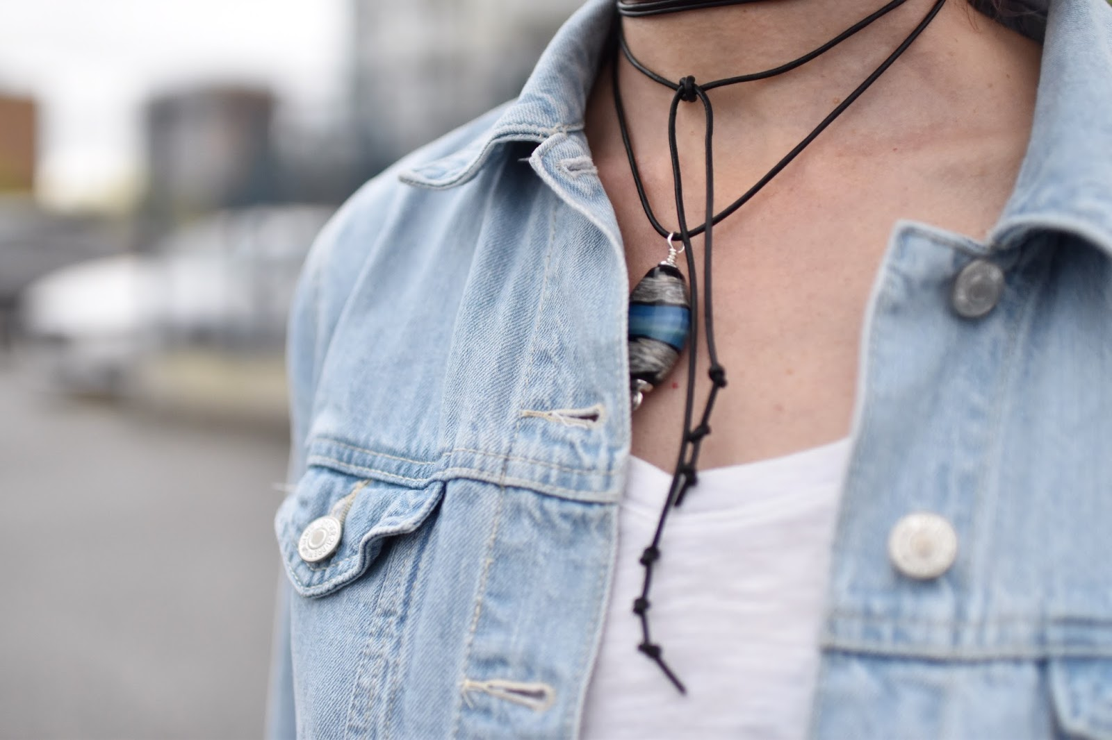 Monika Faulkner outfit inspiration - oversized denim jacket, slouchy t-shirt, glass bead pendant