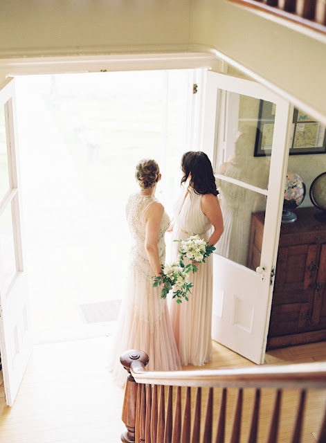 Two brides Jonna and Heather before the ceremony at their Inn at West Settlement Wedding by Karen Hill Photography