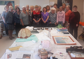 Guilde Repentigny members and some of the works on display at the 10th Anniversary celebration