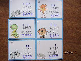 Jungle Animals Adding 4 Digit Numbers with Regrouping Task Cards