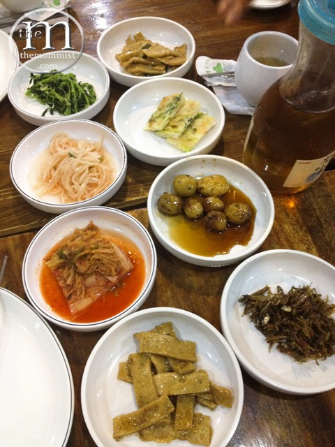 Seven banchan on a table