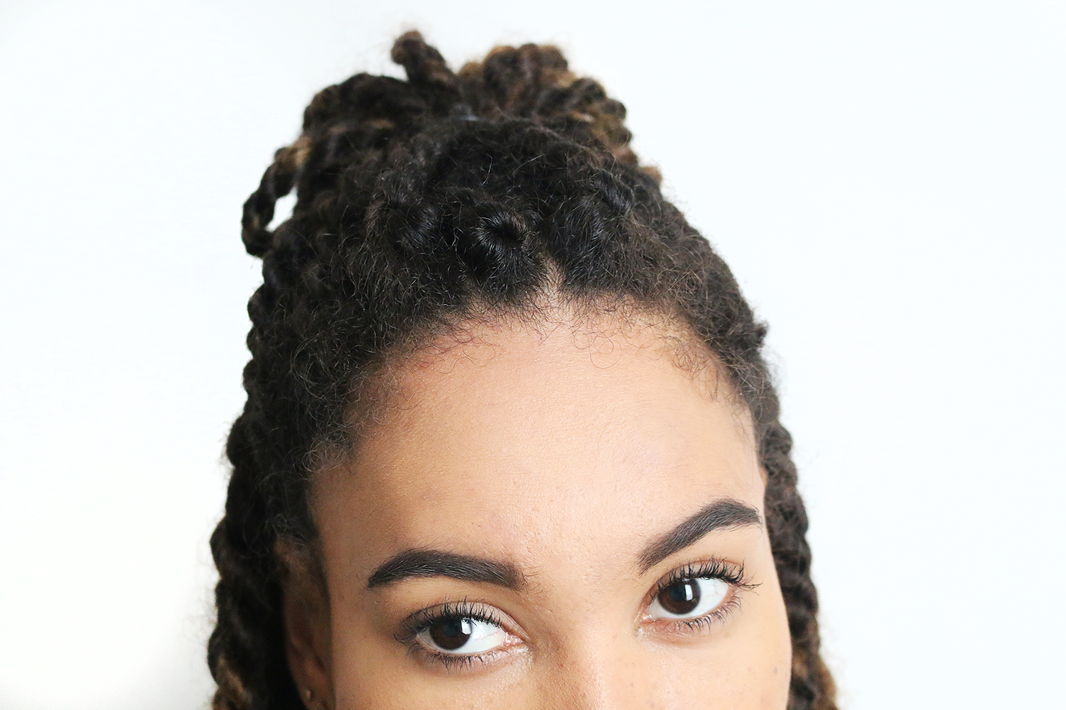 Pulled back marley top knot