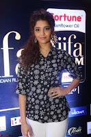 Ritika Singh in Black Printed Shirt and White Leggings at IIFA Utsavam Awards press meet 27th March 2017 17.JPG