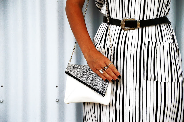outfit details silver rings printed bag and stripe dress