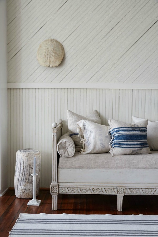 Charming Gustavian daybed with vintage linens in a #FrenchFarmhouse room with #rusticdecor on Hello Lovely Studio