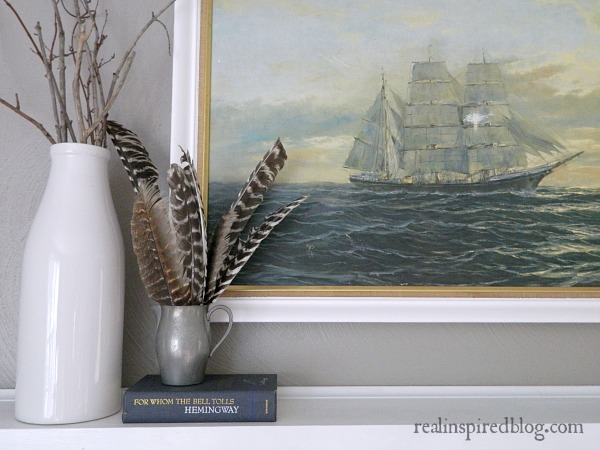 smoked oyster wall color white trim nautical mantel decor ship painting turkey feathers white vase sticks branches blue book hemingway silver pitcher