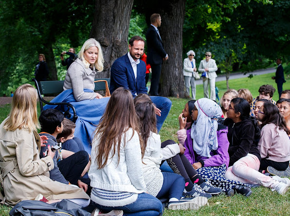 Princess Mette Marit and Prince Haakon and visits the Summer Library at the Palace Park. Princess Mette Marit wore Valentino dress