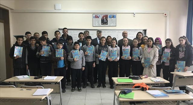 Students holding Albanian language textbook in a classroom in Turkey