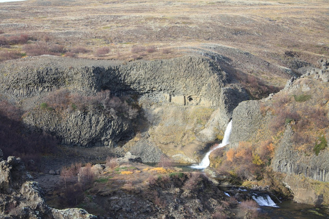 Waterfalls and rock formations at  Gjáin Gorge in Iceland.