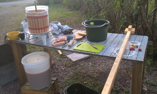 work table rigged for apple cider production