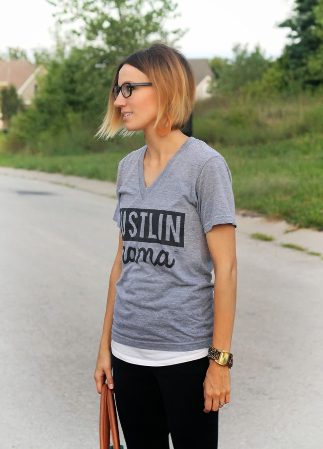 Graphic tee, black denim, black glasses