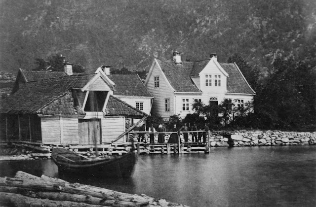 This photo taken in 1877 shows the guest house on the right with accommodations for four  and the general store to the left.