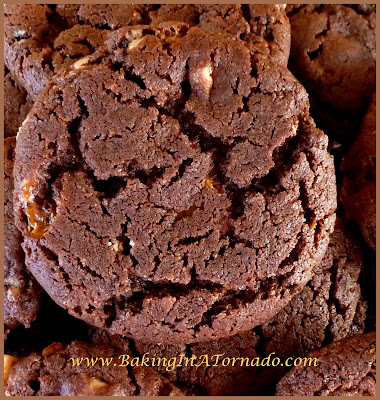 Toffee Butterfinger Crunch Cookies: A chocolate cookie with the crunch of toffee and butterfingers | Recipe developed by www.BakingInATornado.com | #recipe #cookies #chocolate