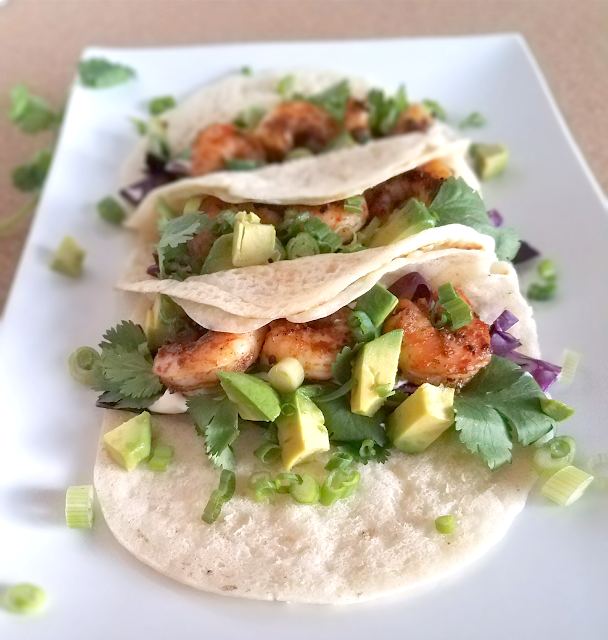 These Shrimp Tacos with Lime Crema are full of flavor yet quick and easy to make! Nutritious, low-carb ingredients provide lots of health benefits, all in a gluten-free, grain-free and vegan tortilla that won't fall apart.