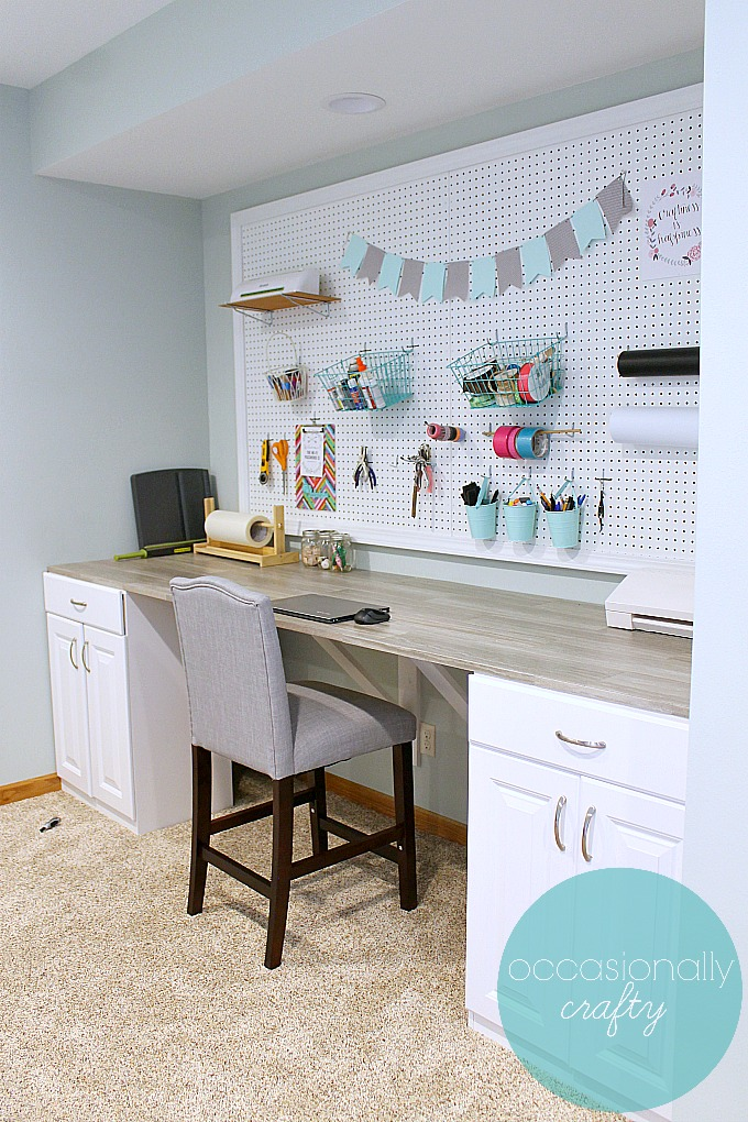 Make your own custom craft table from stock cabinets, plywood, and peel & stick vinyl tiles!