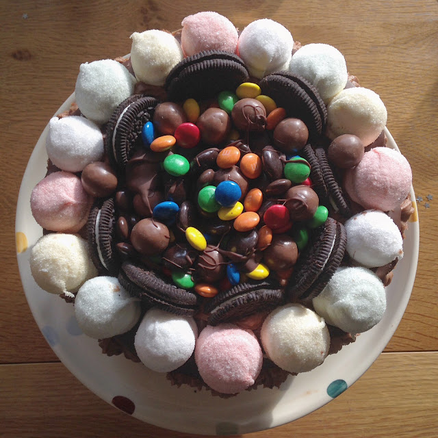 Chocolate birthday cake with smarties, oresos and marshmallows