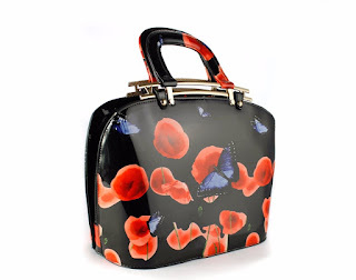Patent leather handbag with butterfly floral design