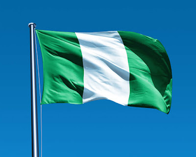 nigerian flag in a blue sky