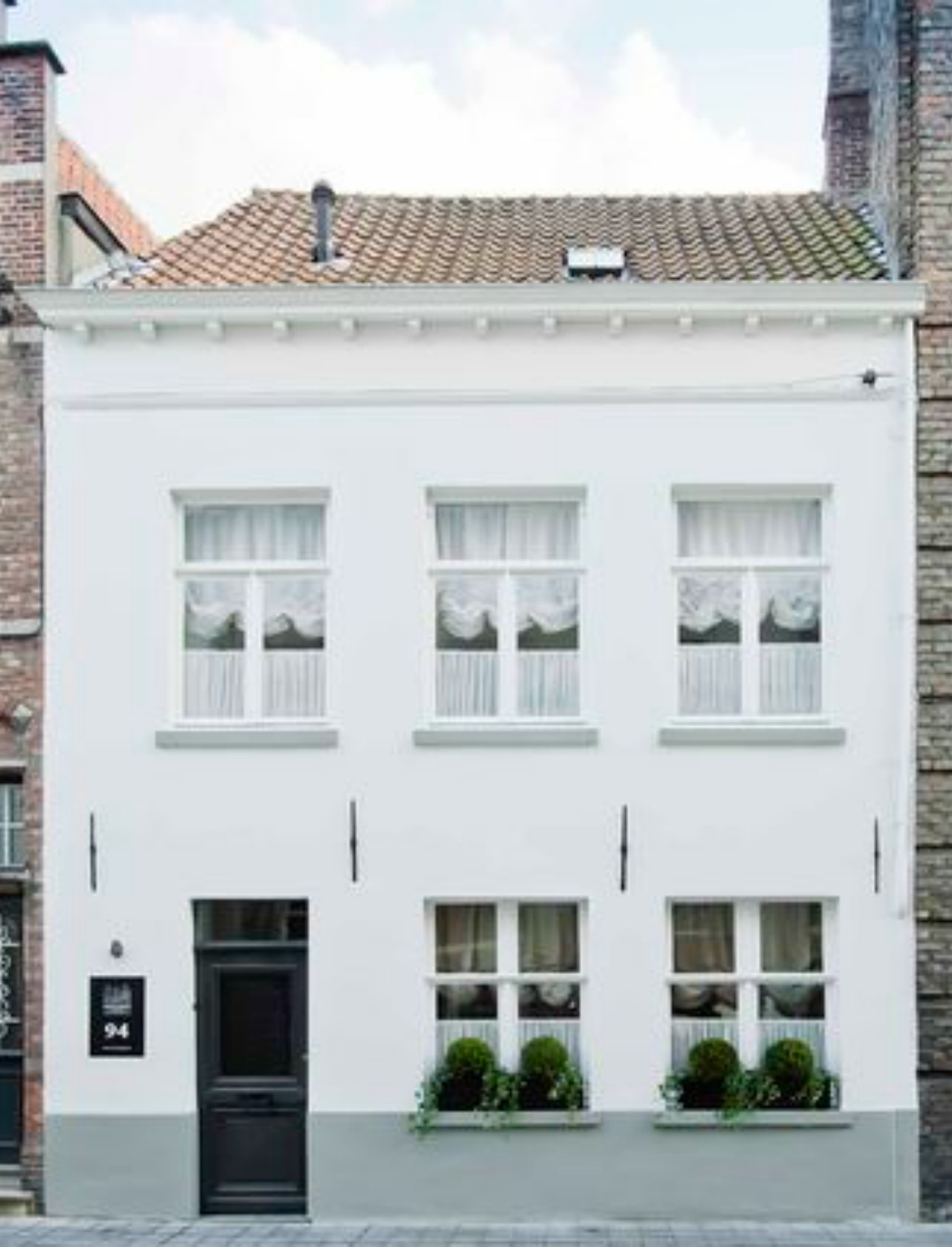 Beautiful Bruges White Rooms exterior - found on Hello Lovely Studio