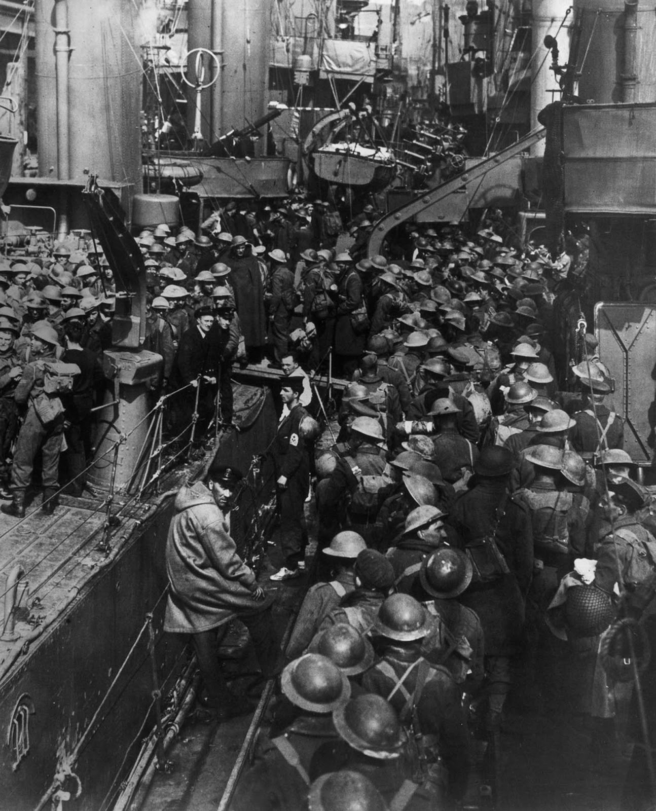 Allied troops crowd aboard ships during the evacuation of Dunkirk.