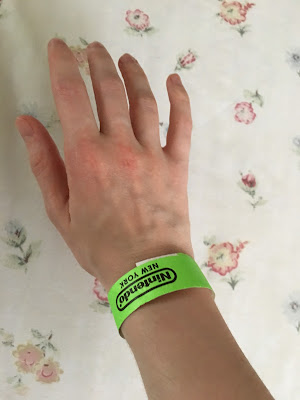 Nintendo NY New York green wristband wait in line