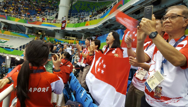 Supporters cheering for Yip Pin Xiu as she competes during the 2016 Rio Paralympics.