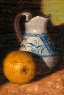 Oil painting of a lemon beside a blue and white porcelain jug.