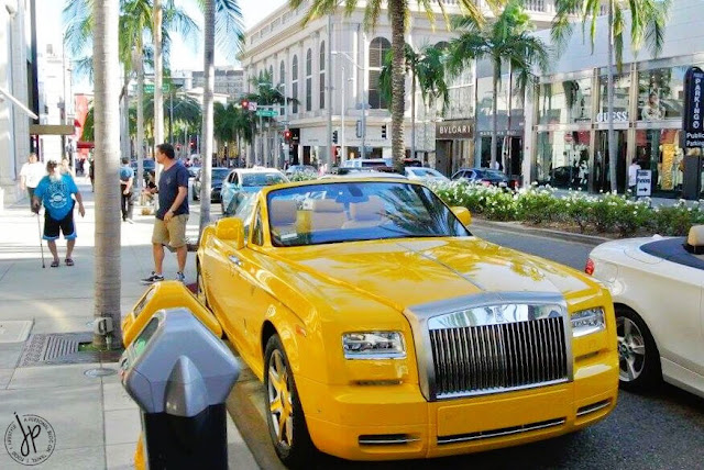 yellow rolls royce car