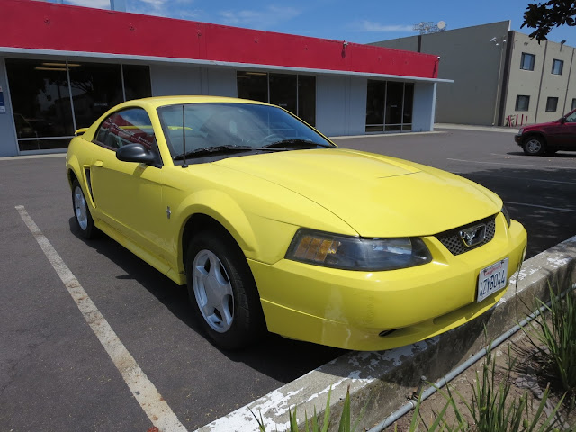2003 Ford Mustang color change from yellow to black.