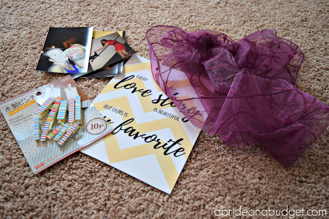 "Want something fun to hang at your wedding reception? Make this BEAUTIFUL -- and easy -- DIY Photo Banner by www.abrideonabudget.com. Plus, it comes with a FREE Kate Spade-esque ""Every love story is beautiful but ours is my favorite"" photo printable."