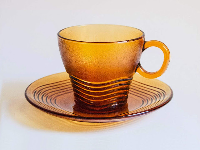 an amber glass cup