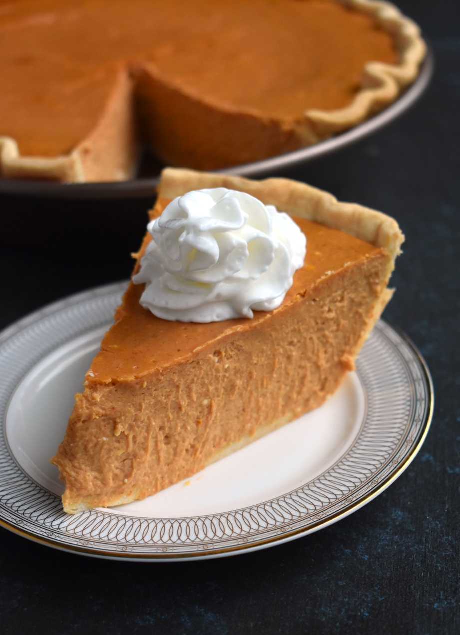 Greek Yogurt Pumpkin Cheesecake is rich and creamy and full of pumpkin spice flavor! Made healthier with Greek yogurt, less sugar and whole-wheat flour! www.nutritionistreviews.com #cheesecake #dessert #pumpkin #greekyogurt #healthier #healthy #holidays
