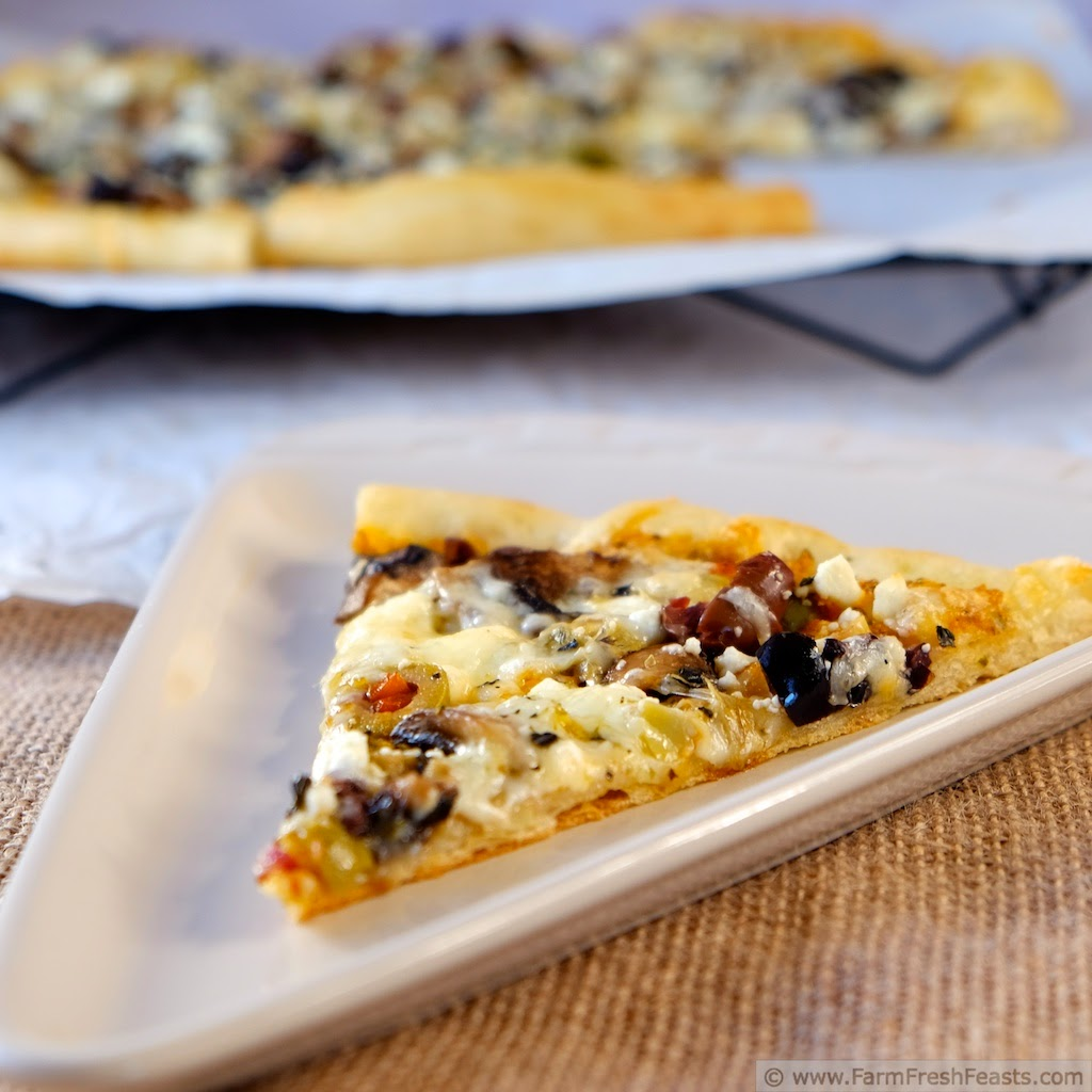 Fresh Tomato Pesto with Mushroom, Olive, Artichoke and Feta Pizza  | Farm Fresh Feasts