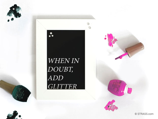 This picture shows a flatlay including a cute quote (when in doubt, add glitter) and some nail polishes.