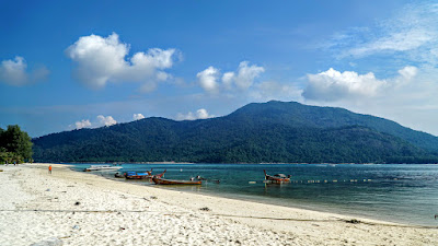 Walking along Sunrise Beach. Koh Adang can clearly be seen in the distance