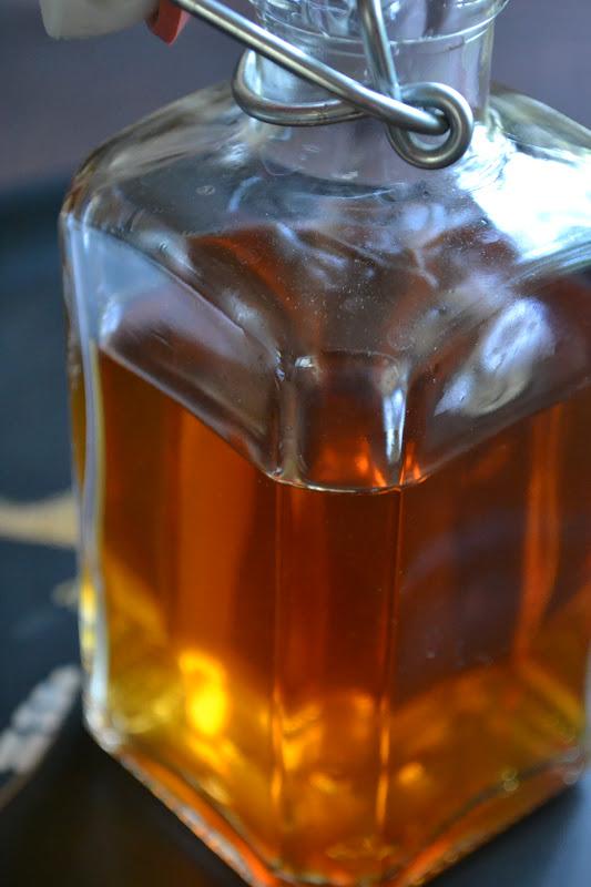 a bottle of homemade allspice dram