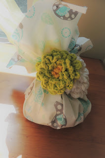 you can create a homespun, earth-friendly gift bag by using your scraps of yarn and fabric