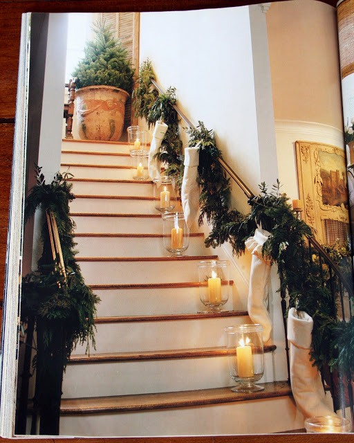 Pamela Pierce Christmas decor on a staircase with garland and stockings. Pamela Pierce.