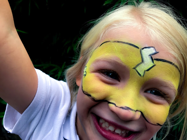 Snazaroo mini theme pack used to create a yellow super hero mask with white lightning bolts and black outline